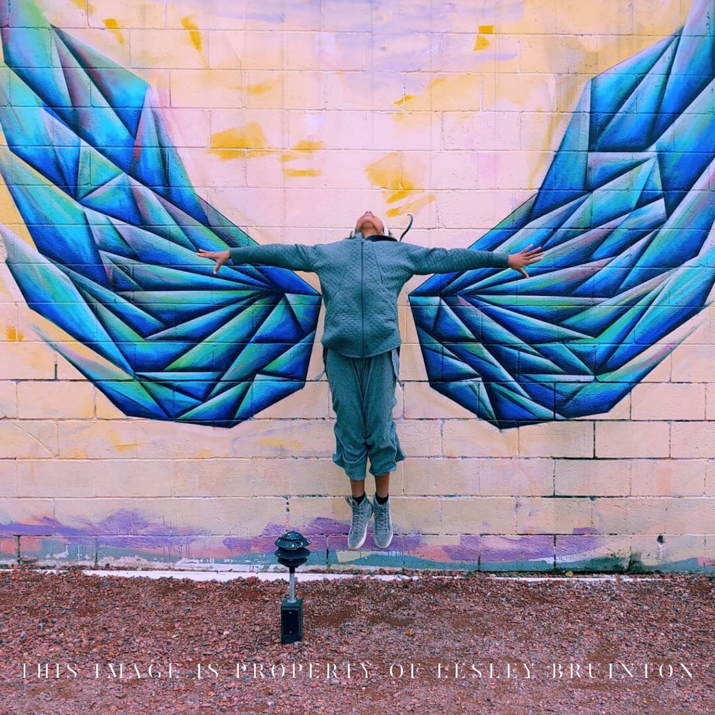 Child with posed with artwork spreading wings